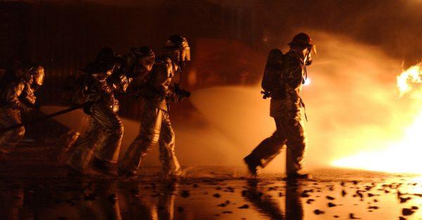 fire fighters approaching blaze