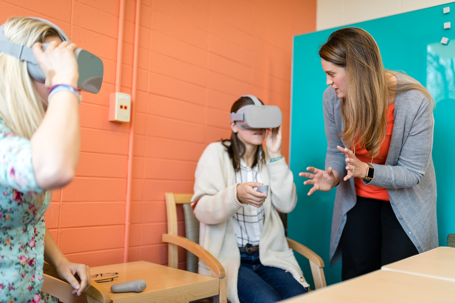 Assistant Professor Meara Faw works with students in the Laboratory for Engaged Communication in the department of Communication Studies in the College of Liberal Arts, May 2, 2019.