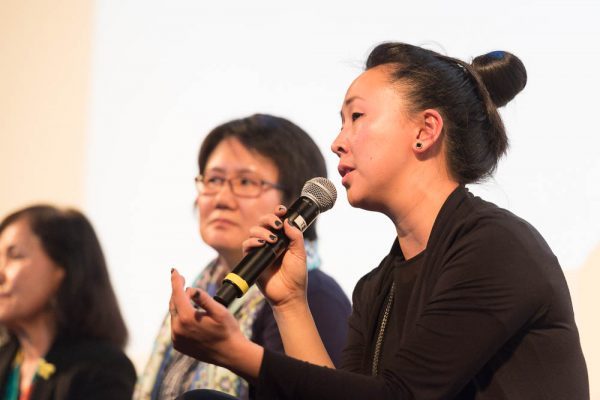 Tiffany Hsiung speaking with microphone