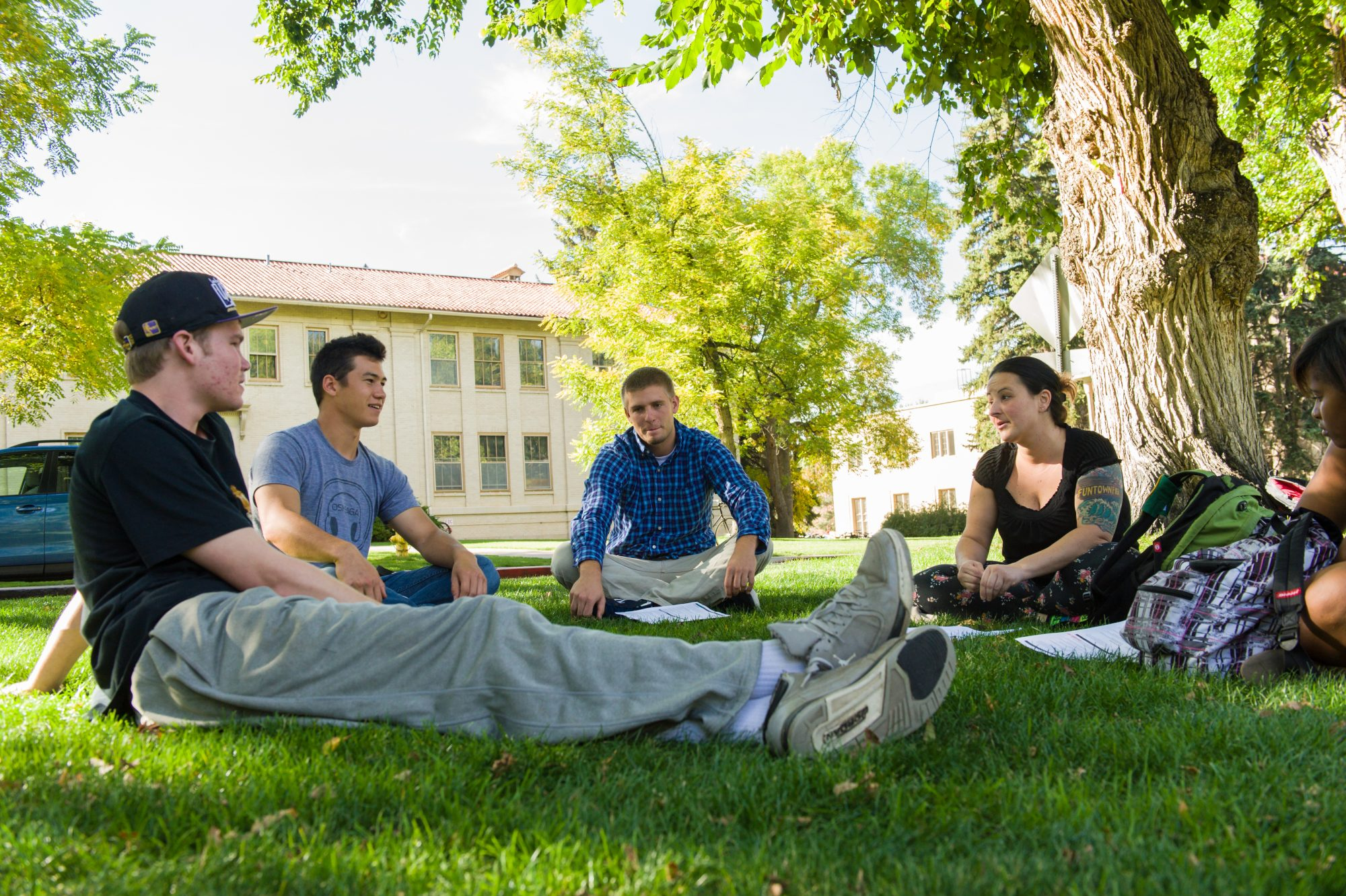 Students sitting outside talking