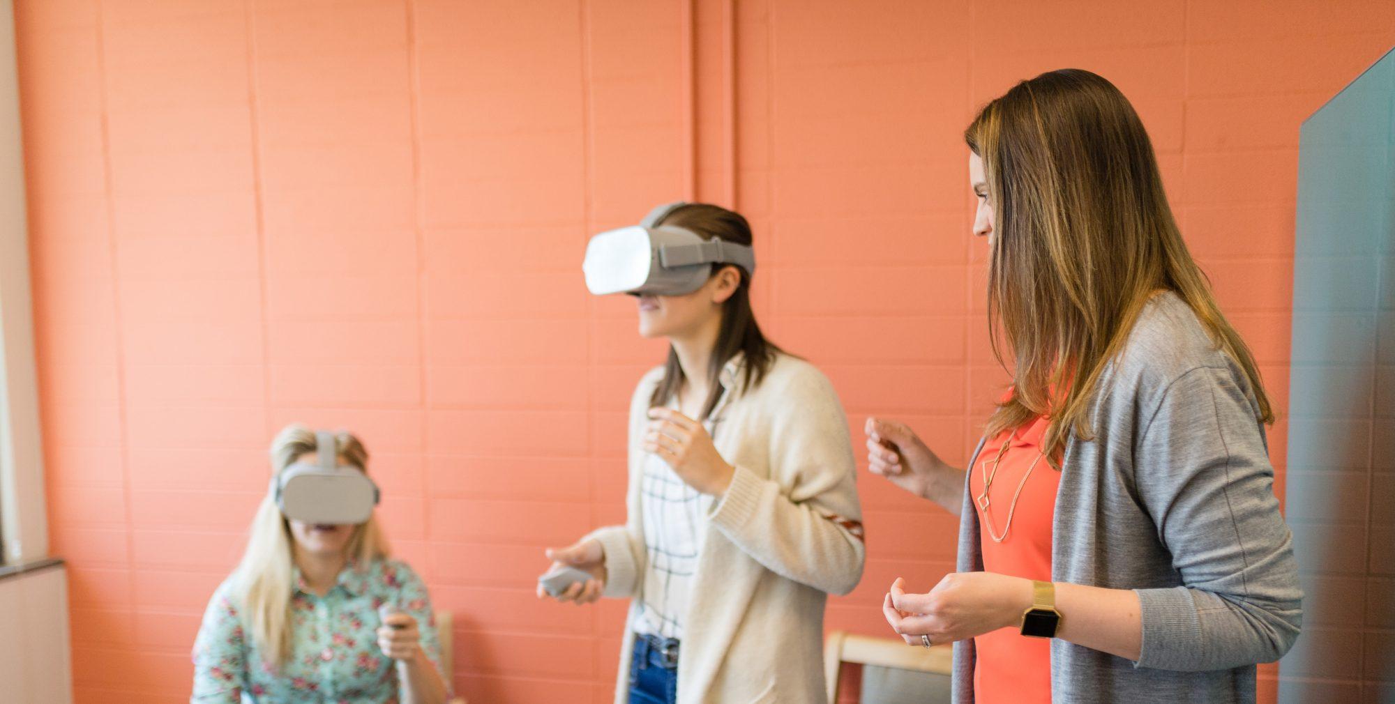 Girls using virtual reality headset