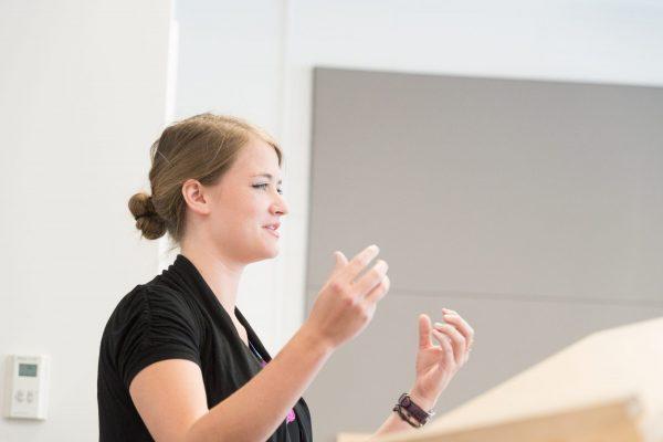 Graduate teaching assistant speaking in classroom