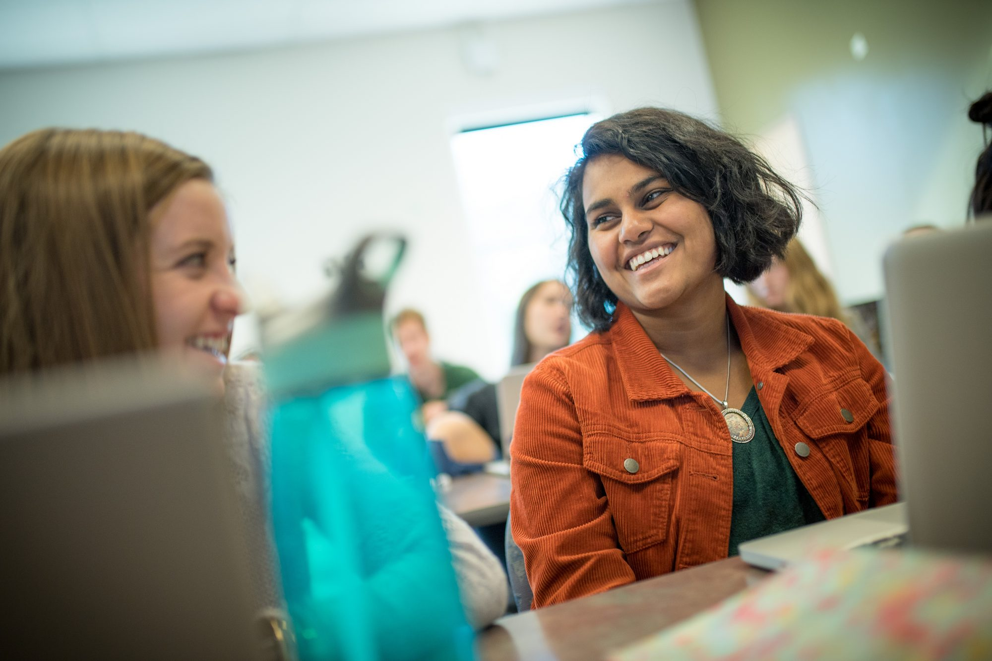 Students laughing and talking during class