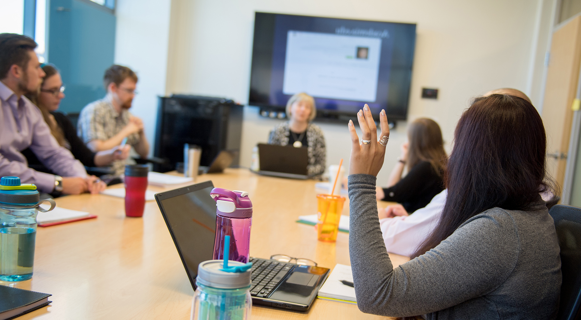Students in group seminar having conversation