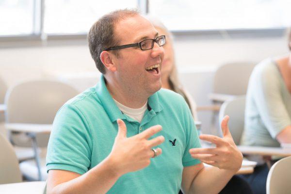 Thomas Dunn talking to students